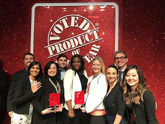 Teams from Gliss and Purex Crystals celebrate at the 2018 Product of the Year award show, held Feb. 8 at the Edison Ballroom in New York City. The event was hosted by comedians Rachel Dratch and Ana Gasteyer.
